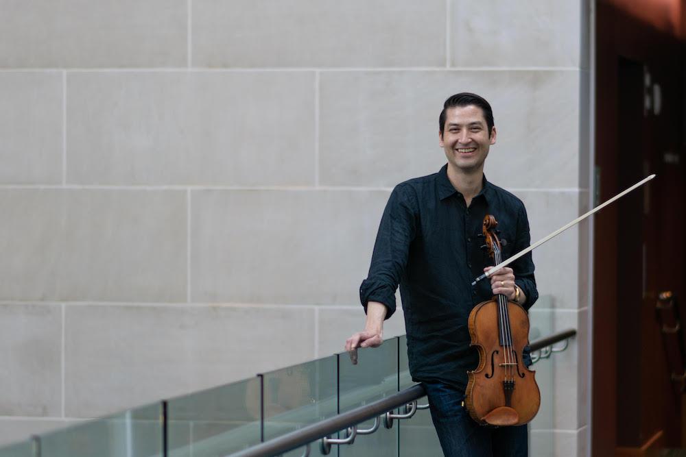 man holding a viola