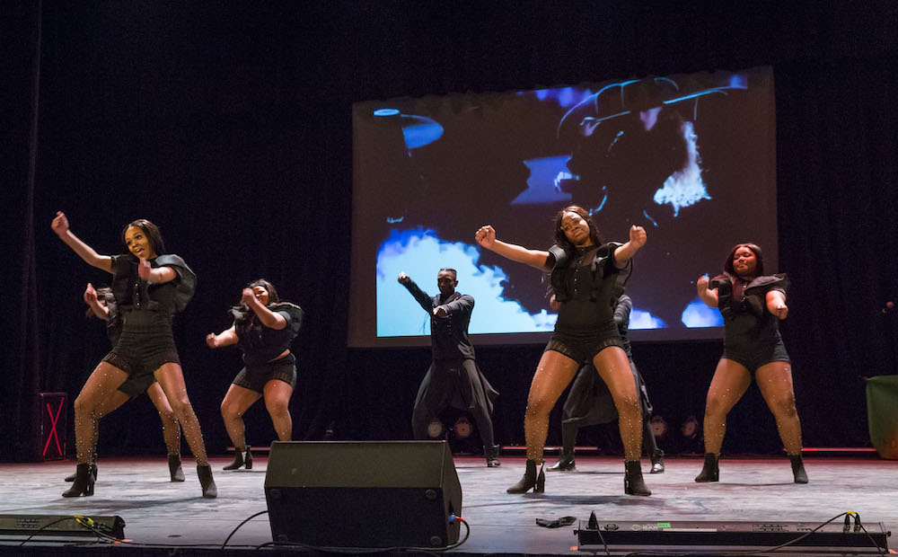 dancers on a stage performing a step show