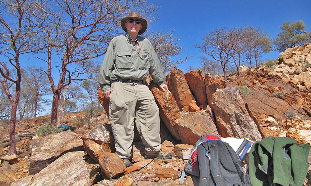 John Tarduno standing on a rocky hillside