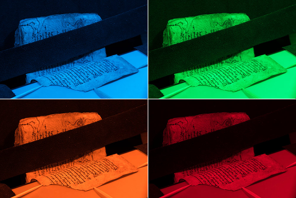 four images side by side of a books scanned with blue light and then scanned with green light as part of the multispectral imaging process.