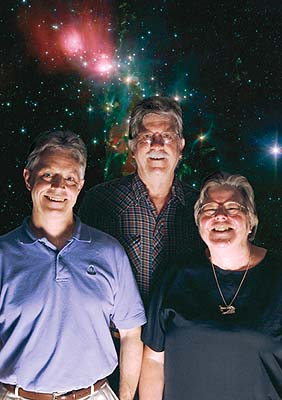 portrait of three people in front of a backdrop showing an image of stars
