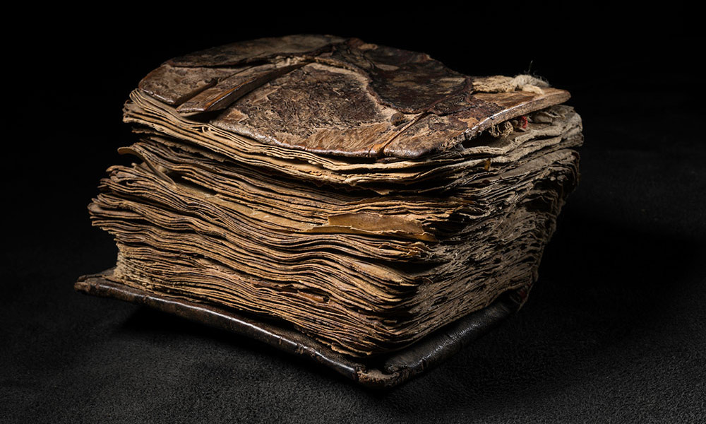 close-up of an ancient prayerbook with the pages open.