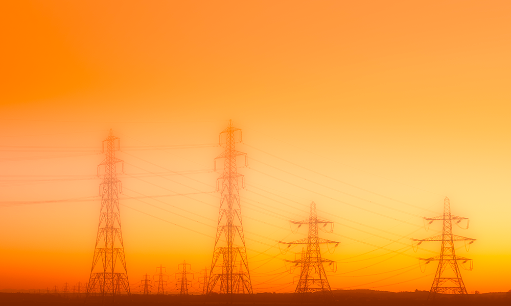 electrical power lines against the backdrop of a hazy sky.