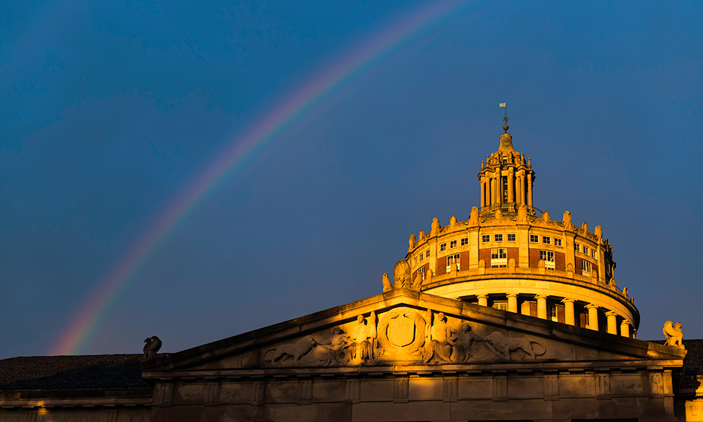 Rush Rhees Library tower with rainbow.