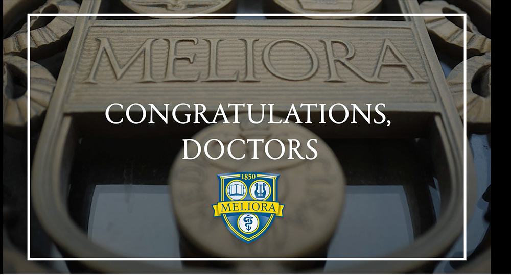 image of still from a video that reads 'congratulations, doctors'