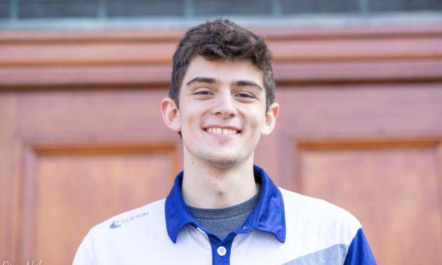 headshot of smiling Fahnestock wearing polo shirt