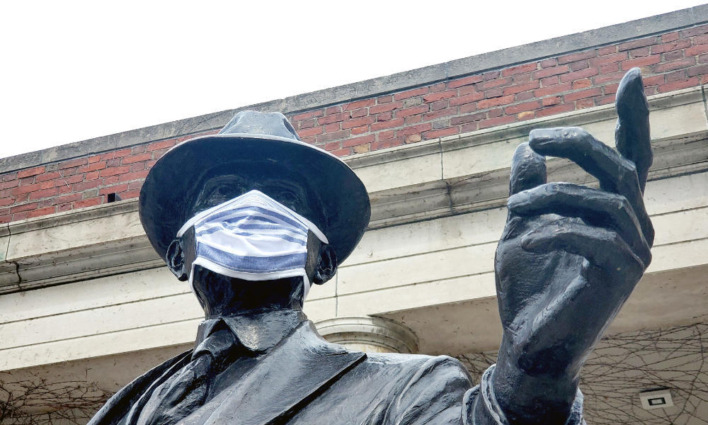 George Eastman statue on River Campus shows Eastman wearing a properly fitted homemade face mask.