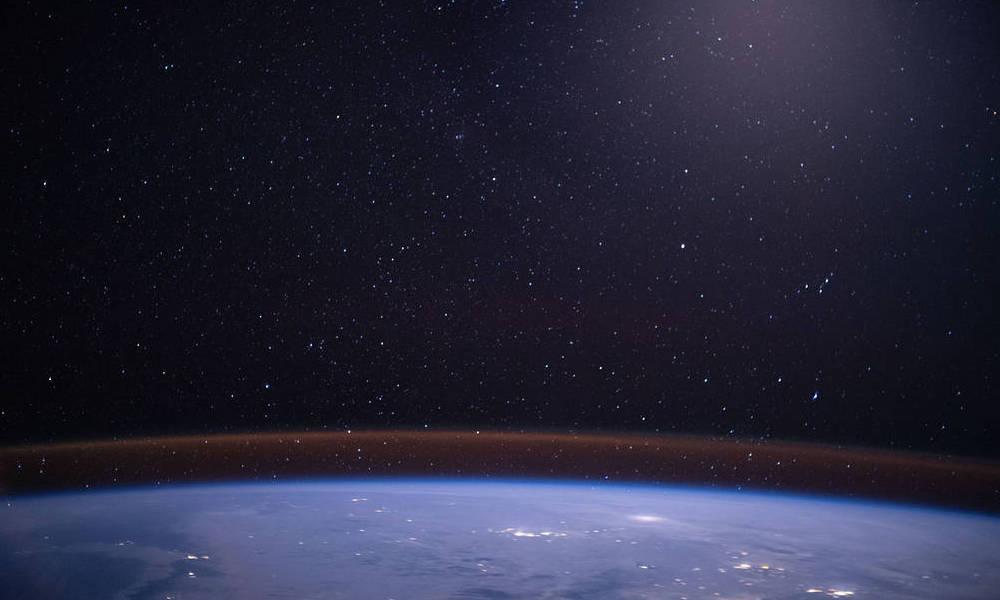 glow over earth's horizon