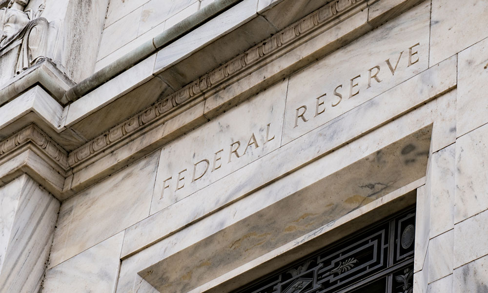 A detail from the Federal Reserve building in Washington, with the name Federal Reserve etched in stone.