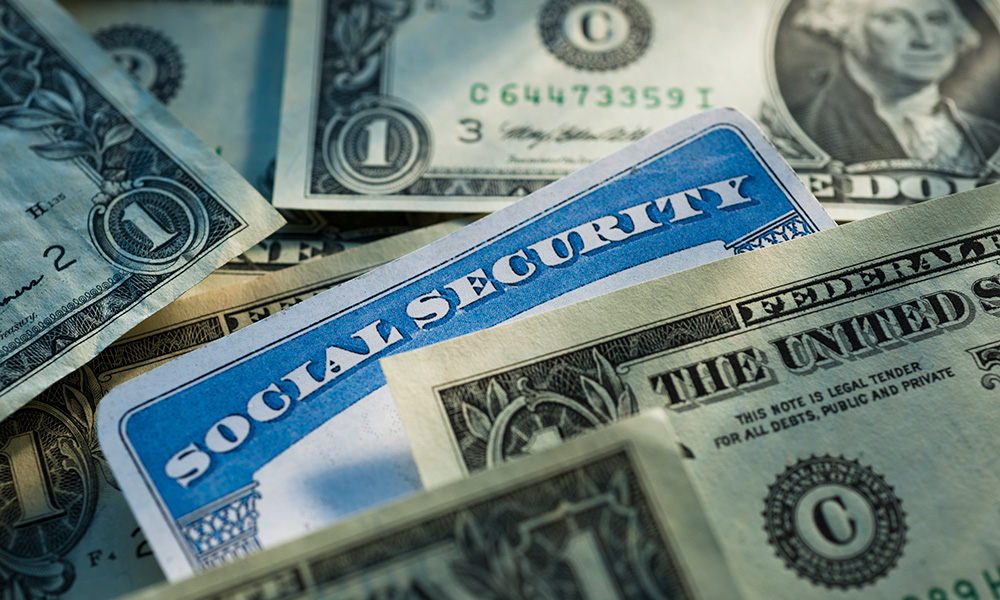 social security card surrounded by money