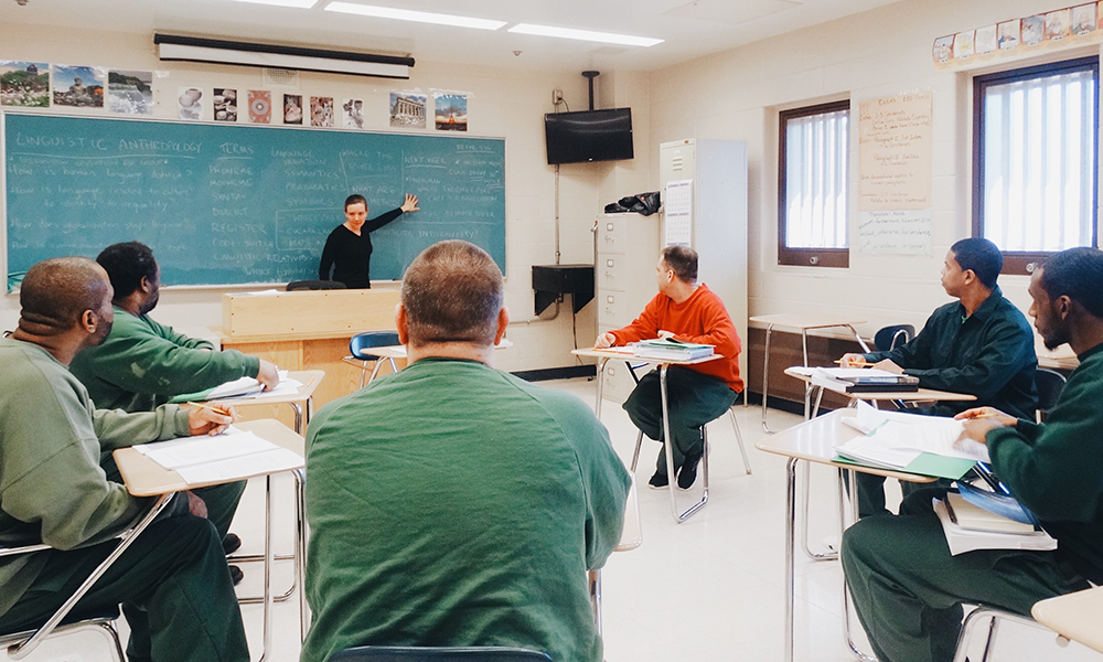 professor teaching prison inmates