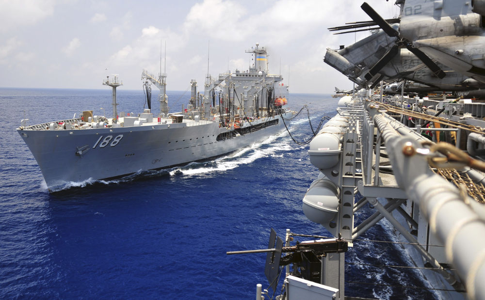 Replenishment oiler USNS Joshua Humphreys refuels USS Boxer.