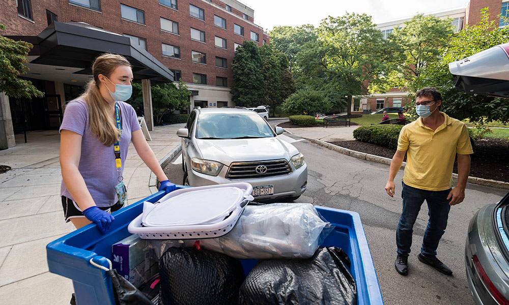 student and parent moving in