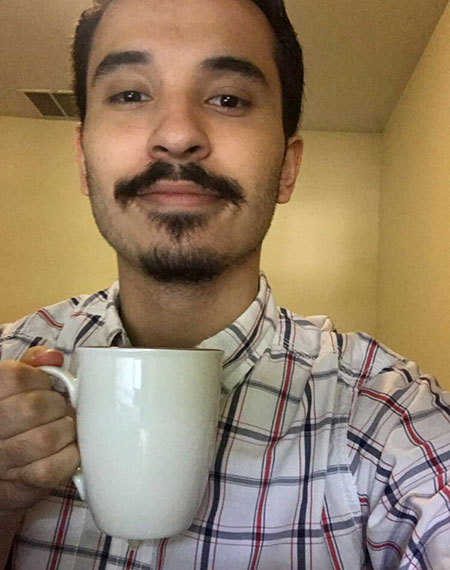 selfie of Cez Garcia, drinking a cup of coffee