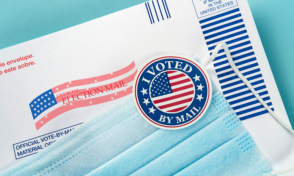 image of mail-ballot and 'I Voted' sticker