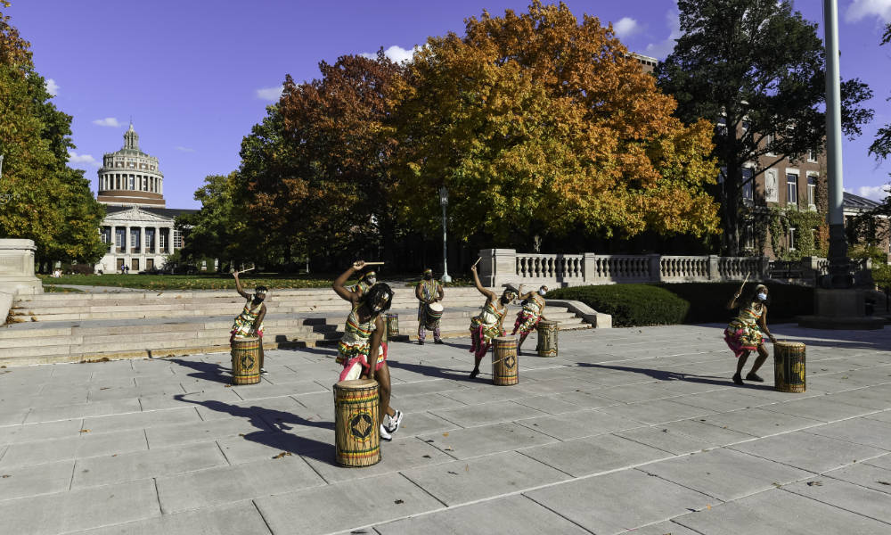 Drummers and dancers perform West African initiation dance on Eastman Quad.