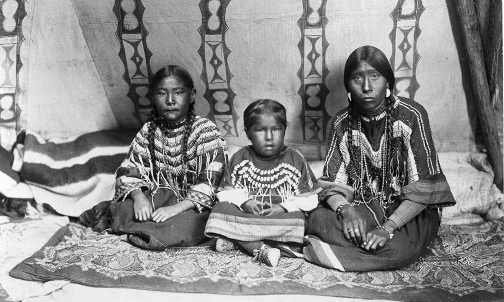 historical photo of a Native woman with two children