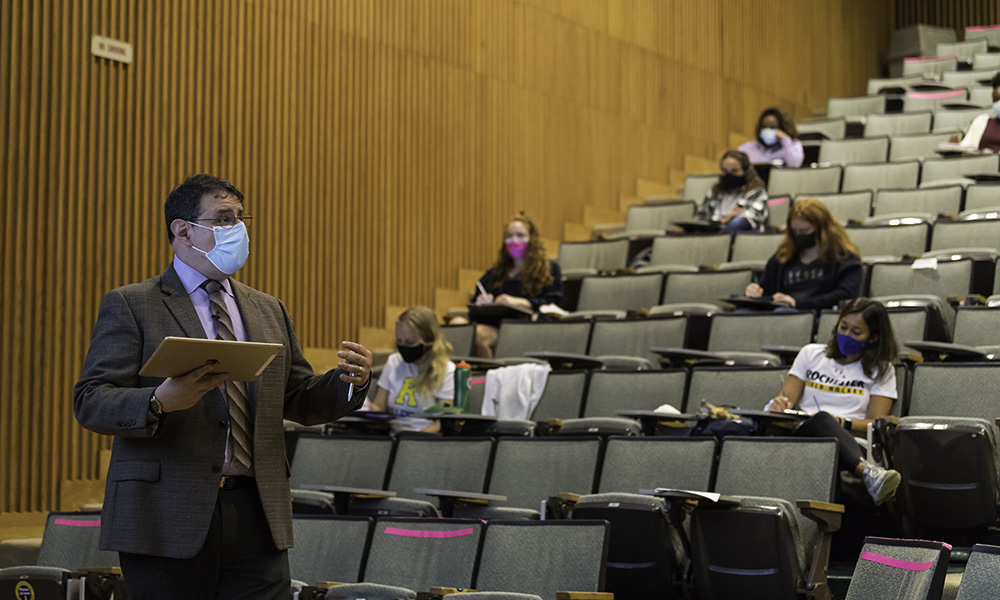 professor speaking in front of a lecture hall