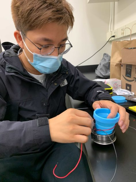 student working on a device