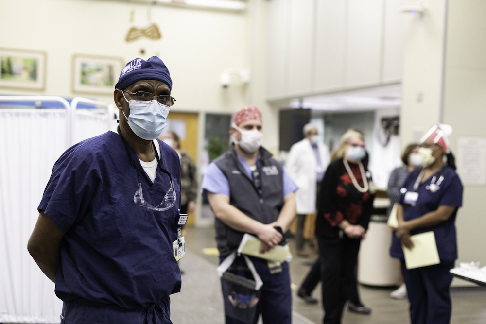 medical workers spaced apart waiting in line