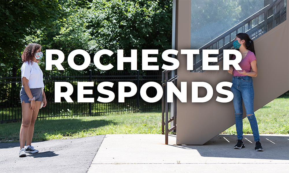 two students, each wearing a mask, standing more than six feet apart, the words ROCHESTER RESPONDS between them