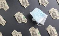 one dollar bills near folded surgical mask