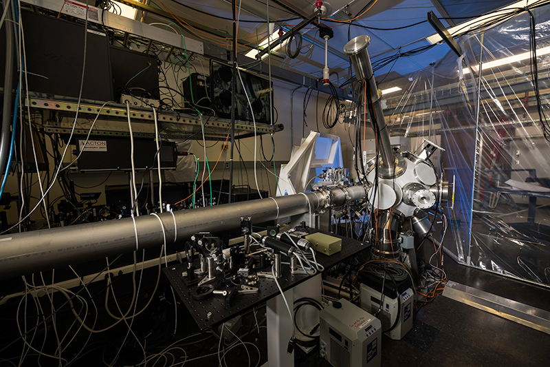 lasers and optical equipment inside a lab.
