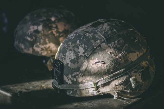 Two military helmets outfitted with WetWare Biosystems technology.