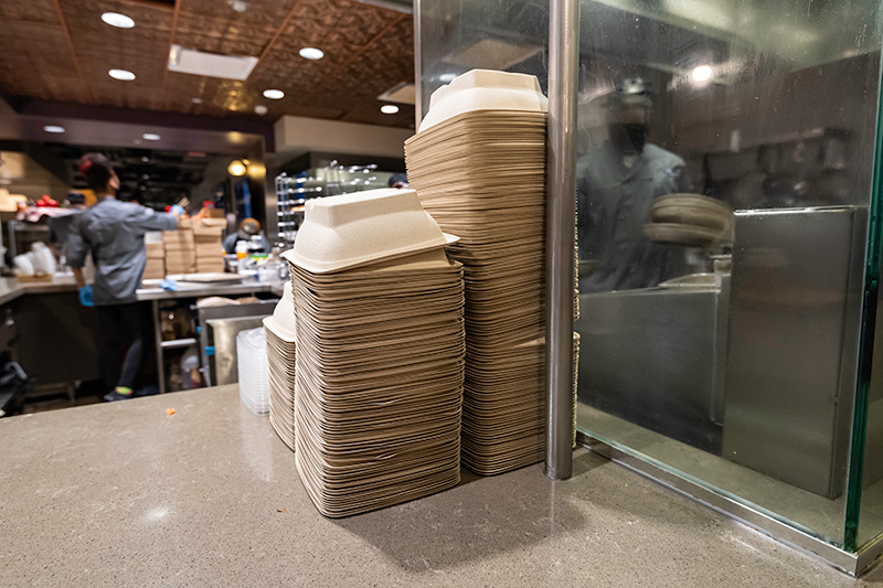 stacks of food containers on a countertop.