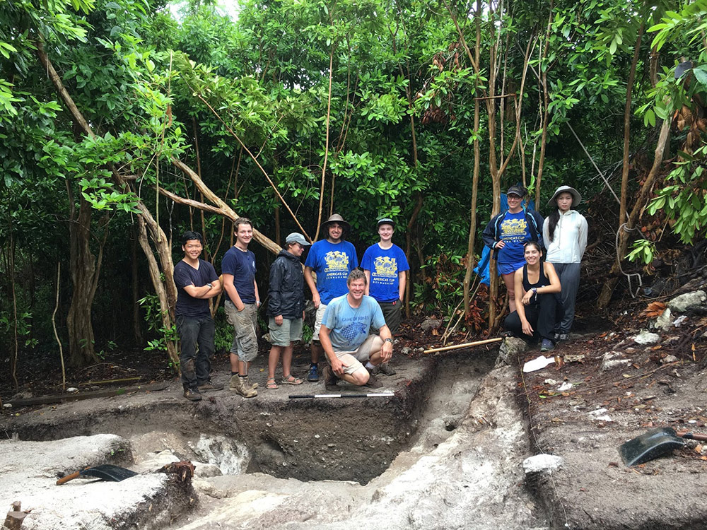a group photo around a excavation site in Bermuda.