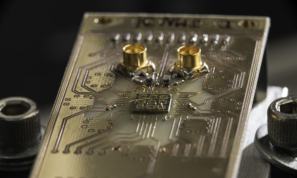 quantum processor semiconductor chip connected to a circuit board