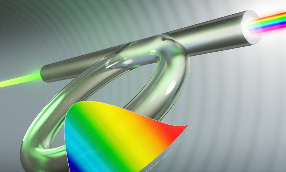 illustration of the optical fiber Kerr resonator with rainbow pattern in foreground.