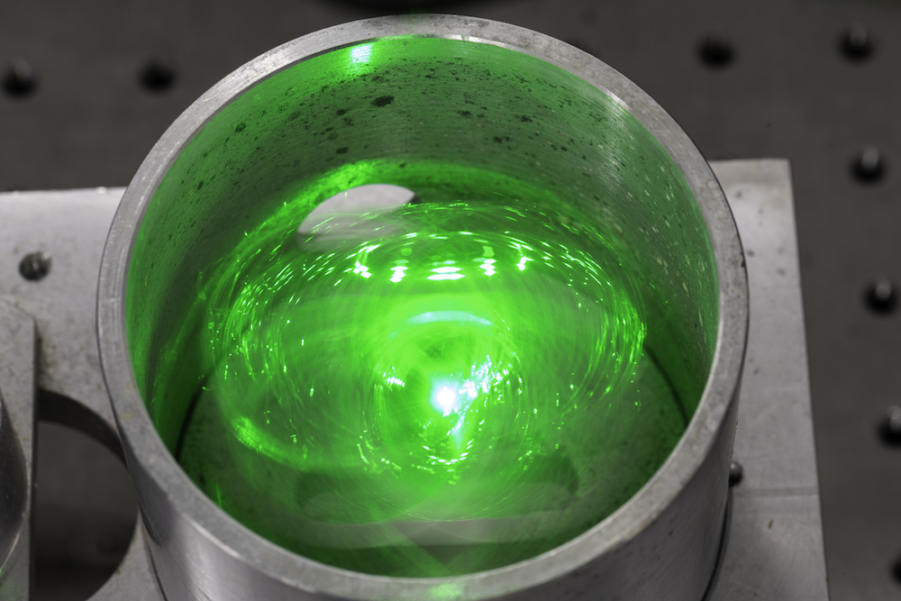 glowing green item inside a container
