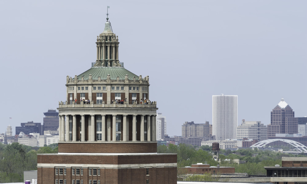 library tower and city skyline illustrate the economic impact of the University of Rochester.