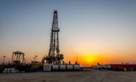 Fracking drill rig at sunset.
