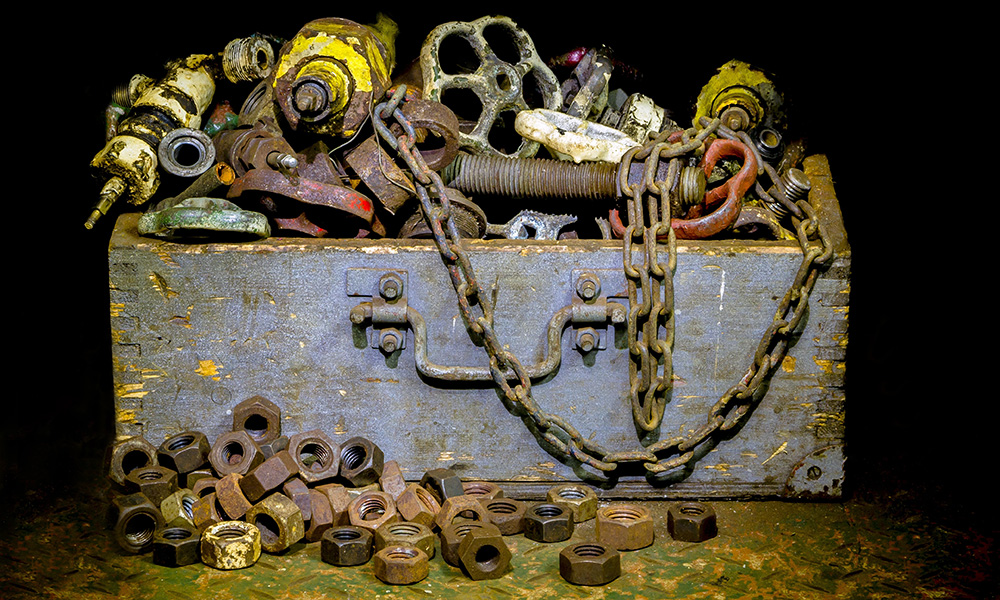 box filled with rusty tools and other junk