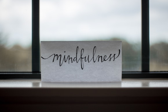 the word mindfulness written on a piece of paper