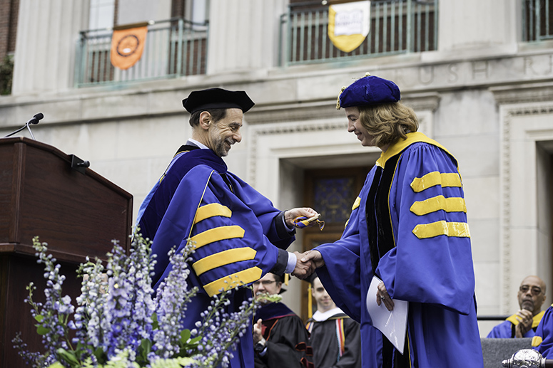 Margaret Georgiadis is awarded the Eastman Medal by University of Rochester president Richard Feldman before delivering the Commencement Address