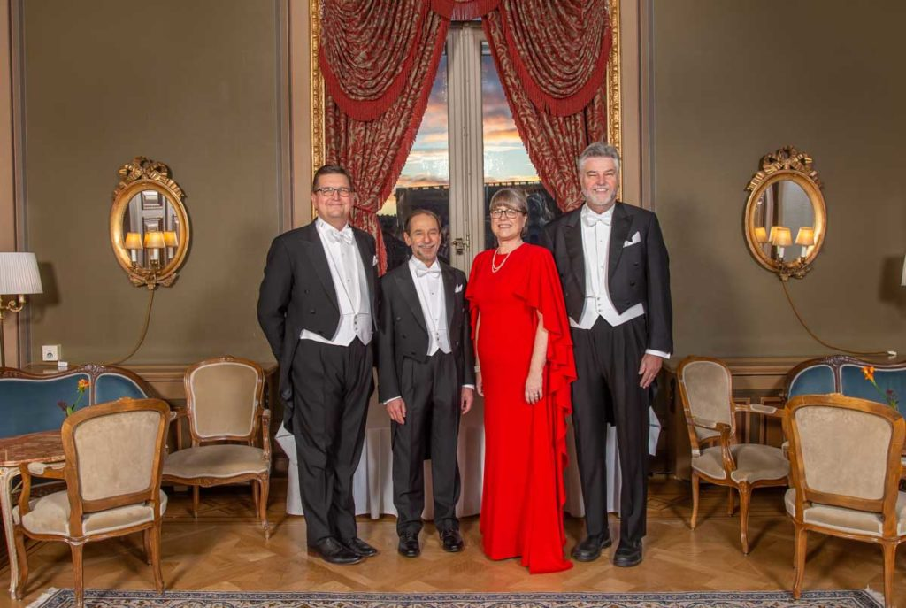Scott Carney, Richard Feldman, Donna Strickland, and Michael Campbell at the Nobel ceremonies
