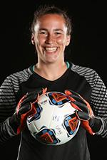 Emma Schechter in soccer gear holding a soccer ball