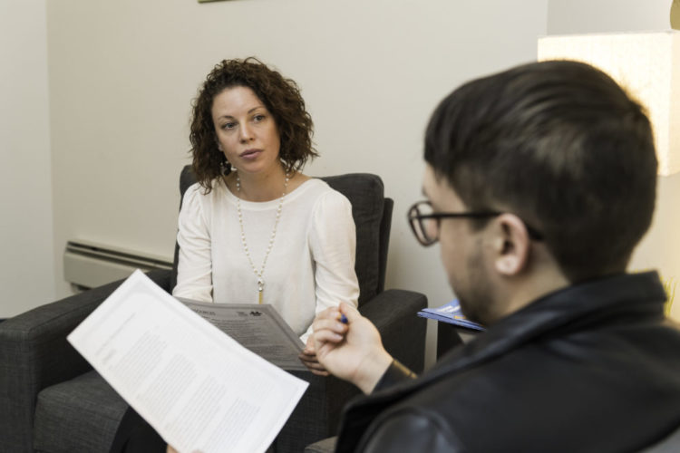 Niki Pizzutelli, left, interim associate director of the University's CARE Network, and grad student Peter Murphy are pictured during a meeting at Niki's office in Wilson Commons April 24, 2018.