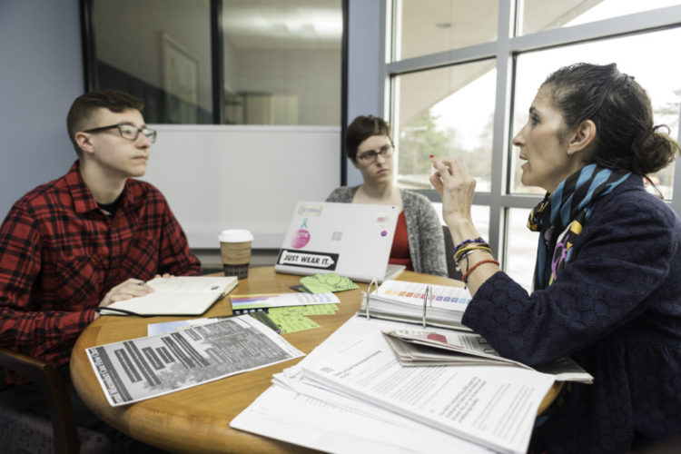 Susan B. Anthony Center Director Catherine Cerulli [R] is pictured with students Nick Kasper [L] and Julia Deluca (both '18) in Meliora Hall April 25, 2018.