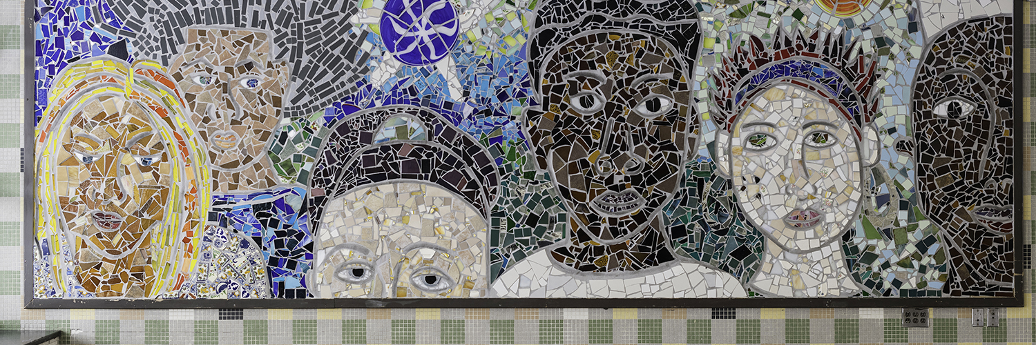 Mosaic of multicultural faces in the lobby of East High