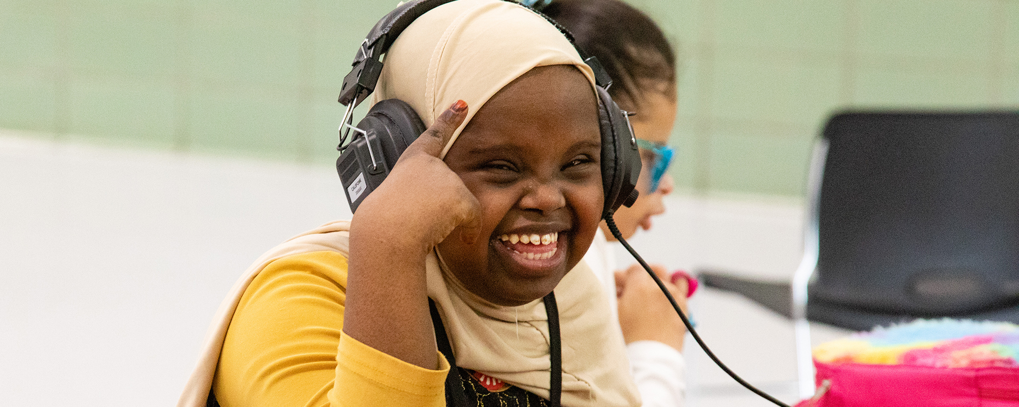 Young woman with a big smile wearing headphones