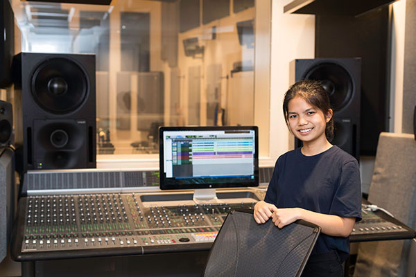 student working in recording studio
