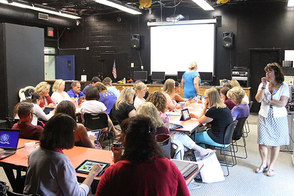 teachers in professional development working at ipads