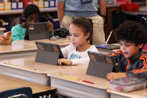 students using ipads in classroom